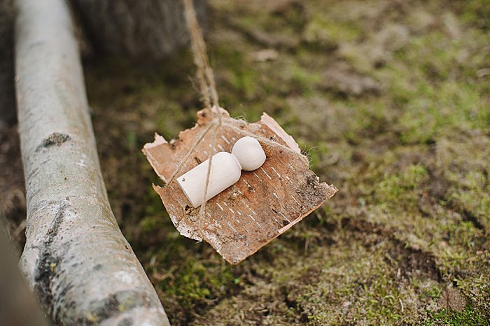 birch bark hammock in nature house fairy house