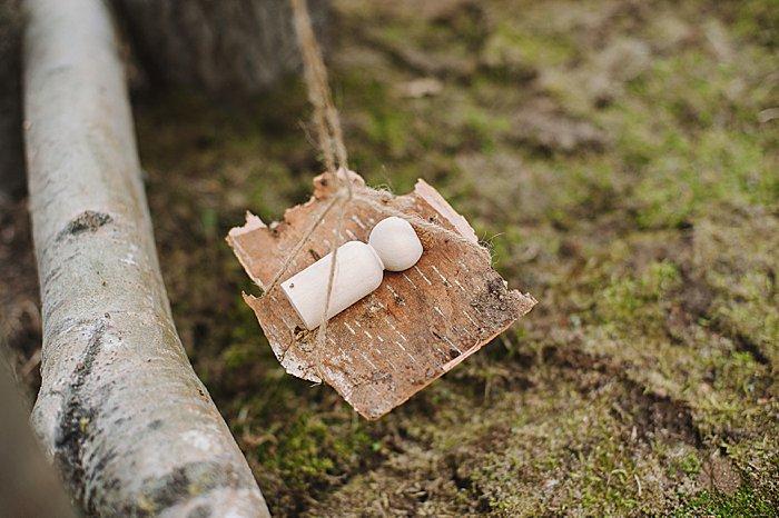 birch bark hammock in nature house fairy house